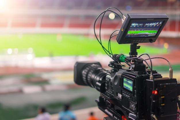 Video camera recording a football match Free Photo