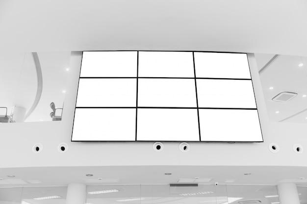 Video wall led screen array billboard setup installation indoor office hall Premium Photo