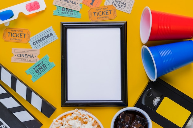 Videotape with clapperboard and a frame Free Photo