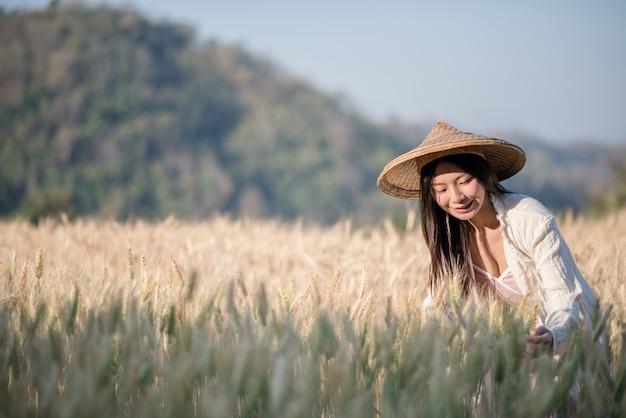Vietnamese female farmer wheat harvest Free Photo