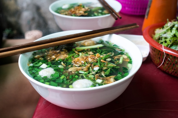 Vietnamese soup with chicken balls Free Photo