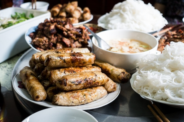 Vietnamese spring rolls on a table Free Photo