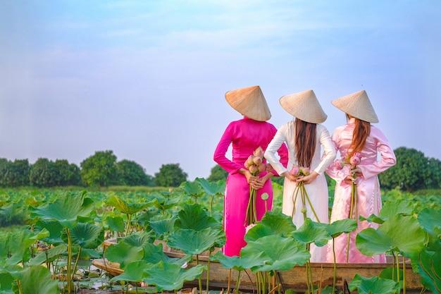 Vietnamese women are collecting the lotus Premium Photo