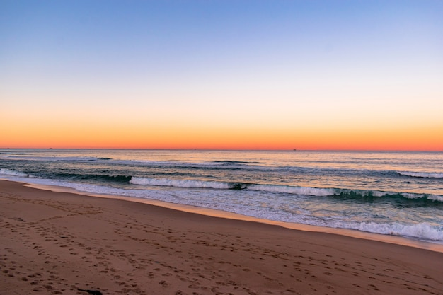 View of an amazing sunset on beach Free Photo
