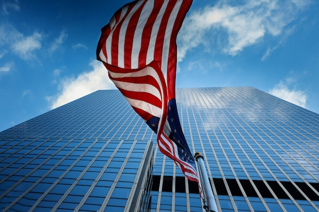 View of american flag on blue building background Premium Photo