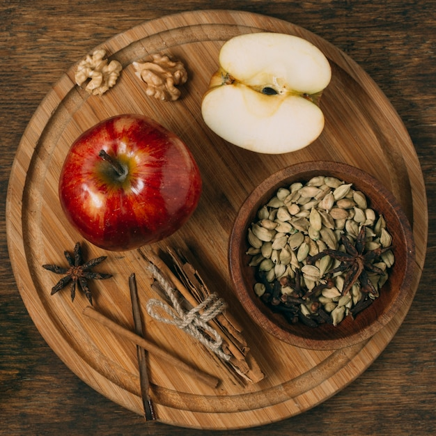 Above view arrangement with apple on wooden board Free Photo