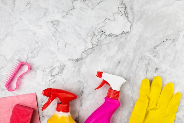 Above view arrangement with cleaning products on marble table Free Photo