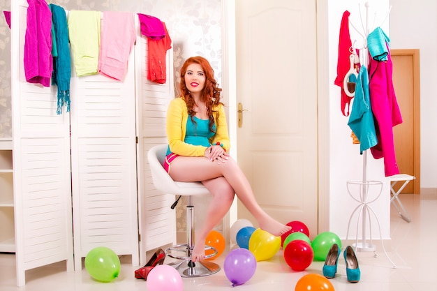 View of a beautiful redhead girl in her colorful bedroom. Premium Photo