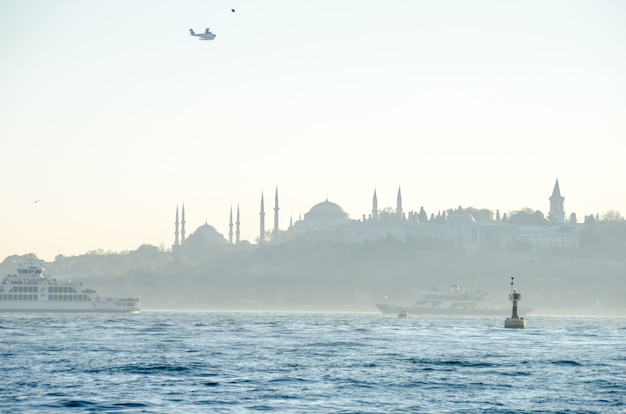 View of the blue mosque, hagia sophia and topkapi palace from the bosphorus strait Premium Photo