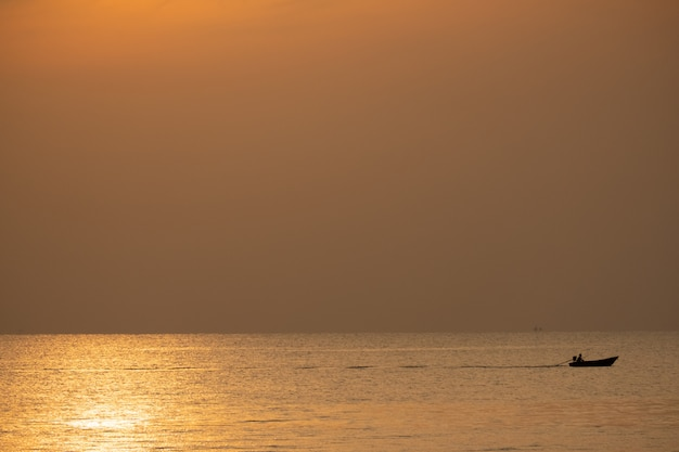 View of boat floating over the sea with sunrise Premium Photo