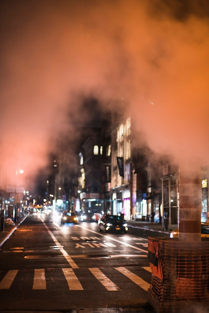 View of busy night road in smoke Free Photo