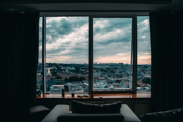 View of the city from a large window of a high house Free Photo