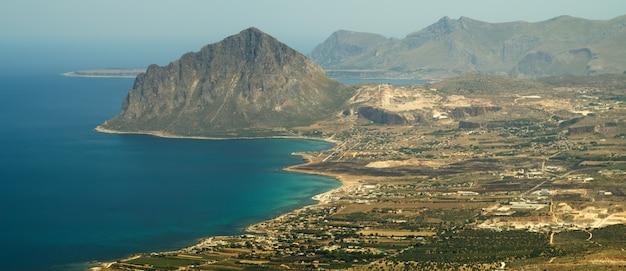 View of cofano mount and the tyrrhenian coastline from erice Premium Photo