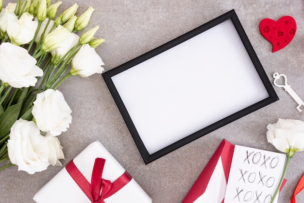 Above view decoration with frame and flowers Free Photo