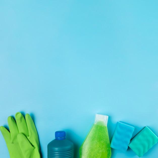Above view detergent bottles and gloves arrangement Free Photo