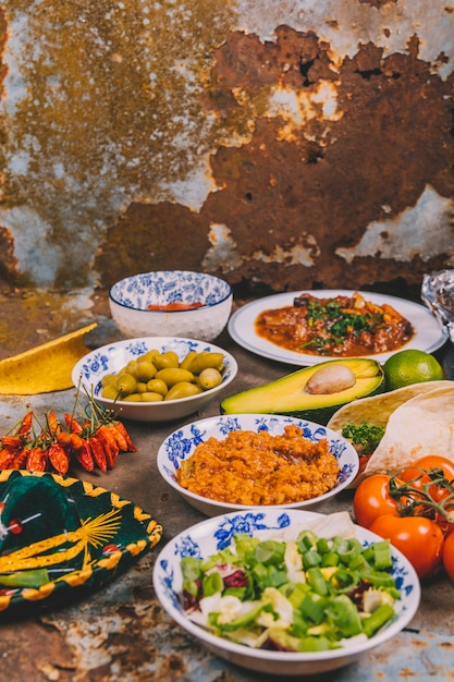 View of different delicious mexican dishes over rusty background Free Photo