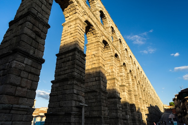 View of the famous aqueduct of segovia with beautiful shadow Free Photo