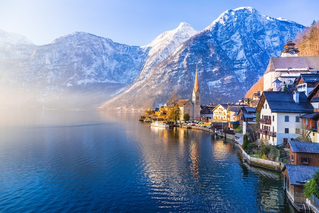 View of famous hallstatt town with lake and mountains seen in one beautiful morning Premium Photo