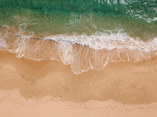 View of foam waves on seaside from above Free Photo