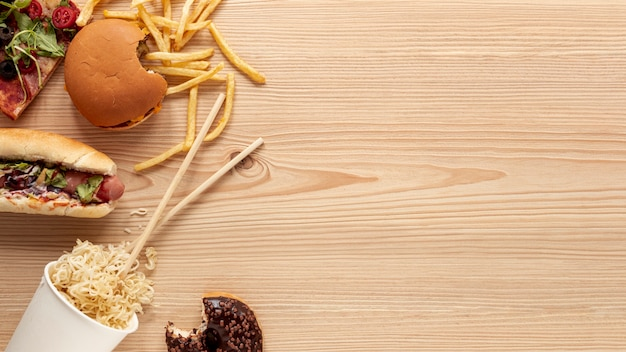 Above view food decoration with wooden background Free Photo