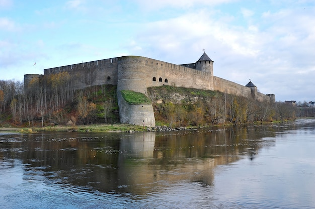 View of the fortress across the narva river in ivangorod Premium Photo