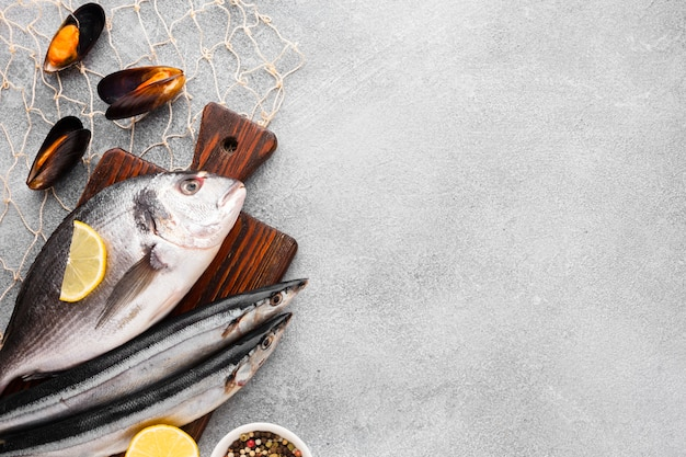 To view fresh fish on wooden bottom Premium Photo