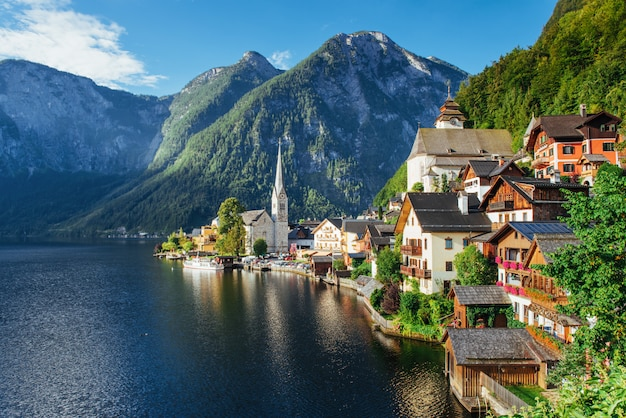 View from height on hallstatt town between the mountains. austria Premium Photo