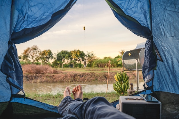 View from inside of tent with relaxing and fishing in swamp Premium Photo