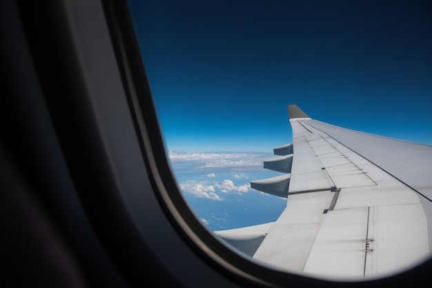 View from plane window to see the sky. Premium Photo