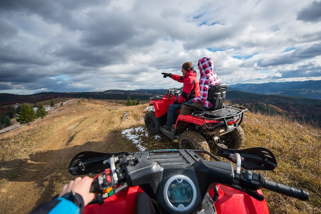 View from a quad bike. couple sitting on atv. Premium Photo