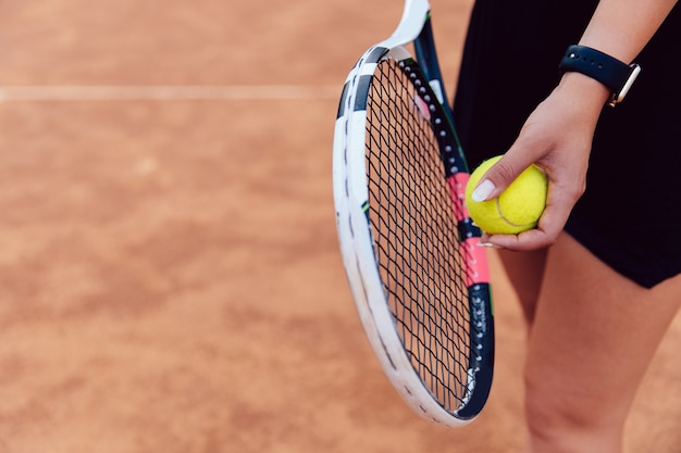 View from above on woman prepares to serve during the match on the tennis court. Free Photo