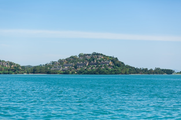 View of a green island in the blue ocean. (no tags with lines. max 2 words) Premium Photo
