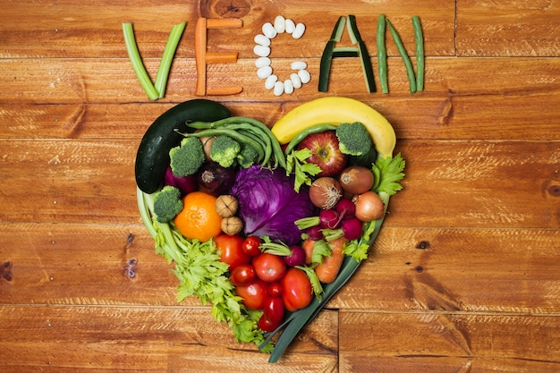 Above view heart shaped vegetable arrangement Free Photo