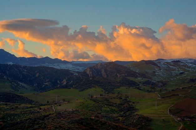 View of hills at sunset Premium Photo