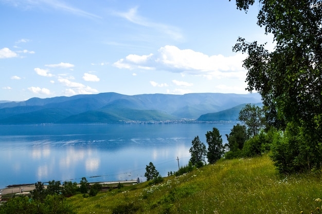 View on lake baikal and beautiful sky with clouds. siberia, russia. Premium Photo