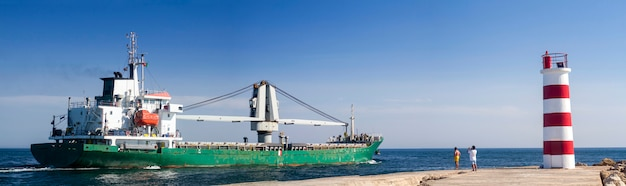 View of a long fishing ship exiting through ria formosa marshlands, located on faro, algarve. Premium Photo