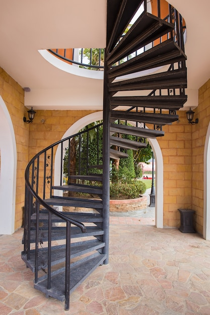 View of a metal dark spiral staircase Premium Photo