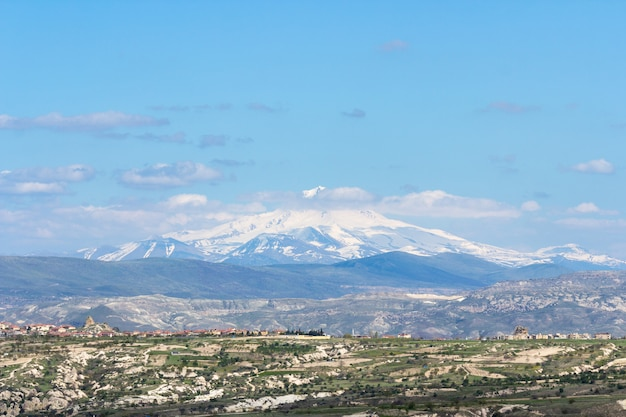 View of the mount erciyes from uchisar castle in cappadocia region Premium Photo