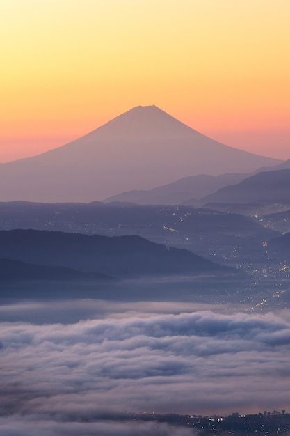 View of mount fuji and sea of mist above suwa lake in morning from takabochi highland Premium Photo