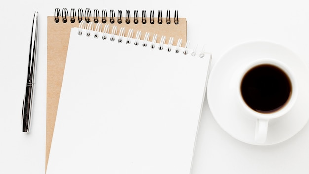 Above view notebook and coffee arrangement Free Photo