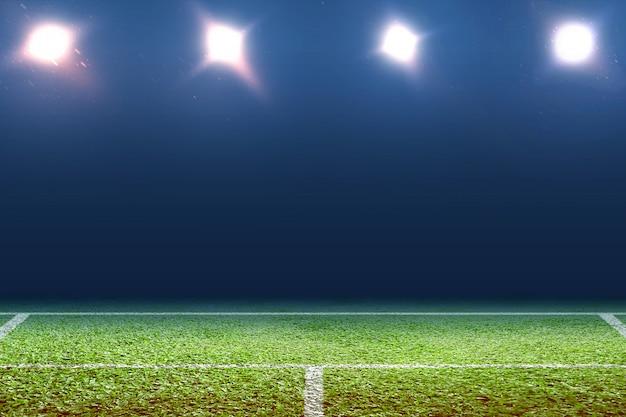 Вид на теннисный корт с подсветкой от прожекторов Premium Фотографии