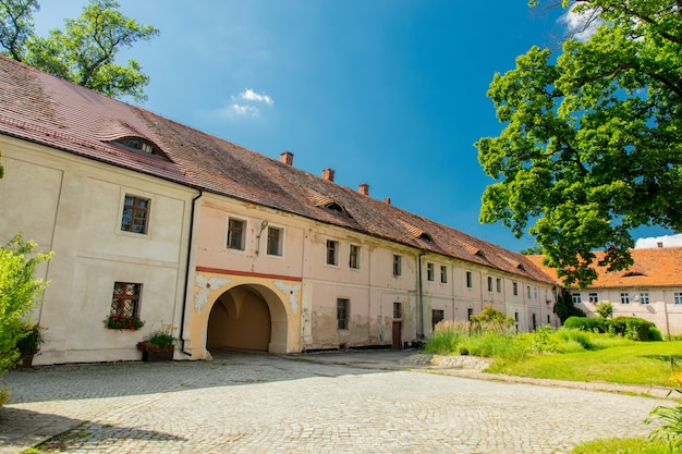 View on old houses in henrykow abbey in lower silesia, poland Premium Photo