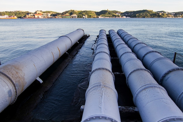 View of old sewage pipes leading to a river. Premium Photo