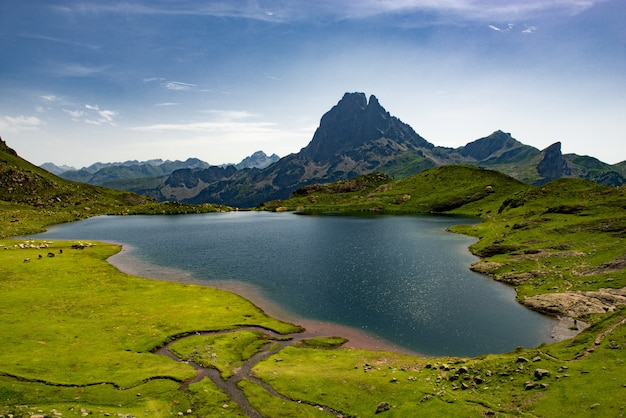 View of the pic du midi d'ossau with lake in the french pyrenees Premium Photo