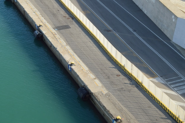 View of the stone and concrete breakwaters along the pier Premium Photo