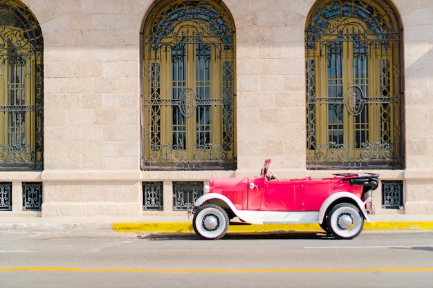 View of a street of old havana with old vintage american car Premium Photo