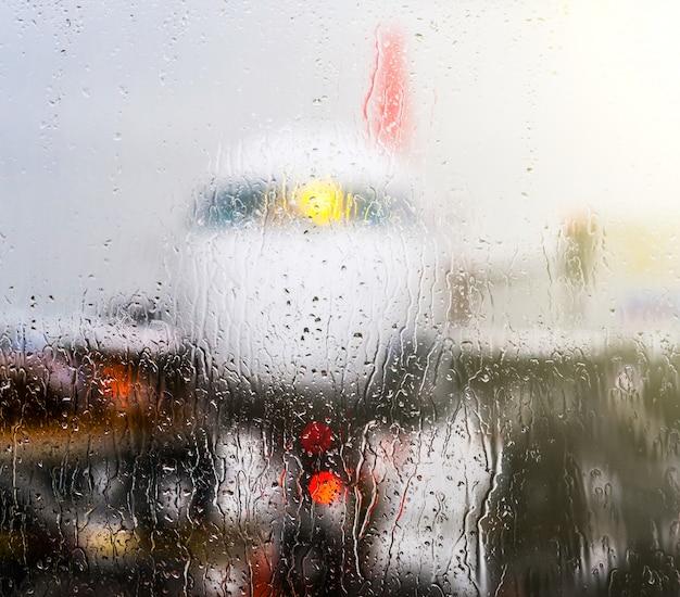 View through window with rain drops Premium Photo