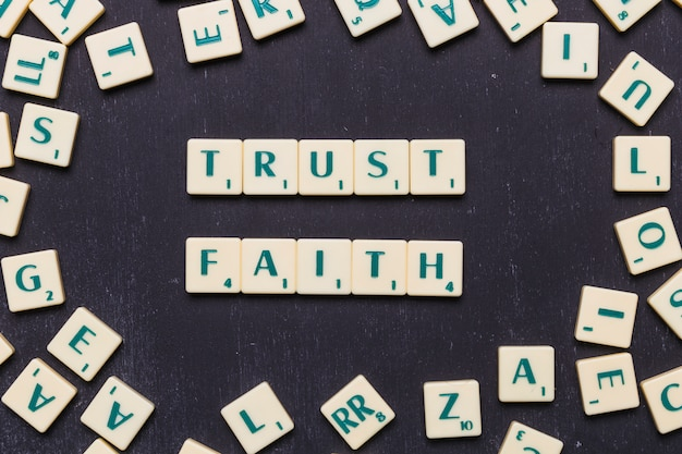 View of trust and faith scrabble letters from above Free Photo