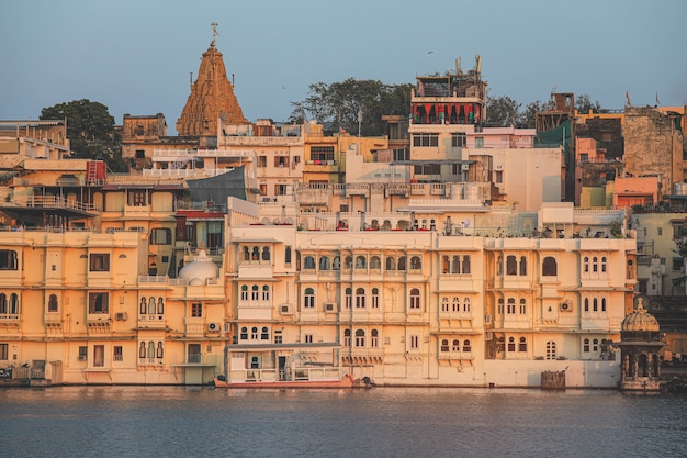 View of udaipur city at lake pichola in the morning, rajasthan, india. Premium Photo