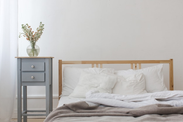 View of an unmade crumpled bed Premium Photo